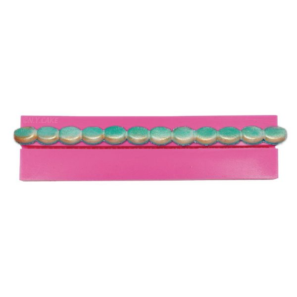 oval silicone bparder. use with fondant to adorn cakes and cupcakes. buy at createdistribution