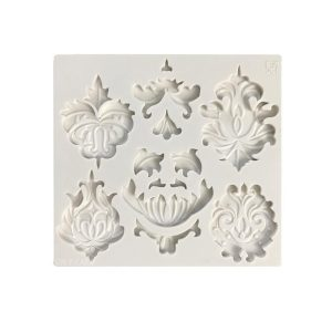adorn cupcakes and cakes with this fancy molds. silicone base and available for purchase on create distribution